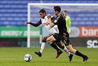 Bolton Wanderers' Brandon Comley competing with Oldham Athletic's Ben Garrity (right) <br /> <br /> Photographer Andrew Kearns/CameraSport<br /> <br /> The EFL Sky Bet League Two - Bolton Wanderers v Oldham Athletic - Saturday 17th October 2020 - University of Bolton Stadium - Bolton<br /> <br /> World Copyright © 2020 CameraSport. All rights reserved. 43 Linden Ave. Countesthorpe. Leicester. England. LE8 5PG - Tel: +44 (0) 116 277 4147 - admin@camerasport.com - www.camerasport.com