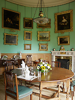 The private dining room is situated in one of the corner towers and the curved walls are hung with gilt-framed paintings