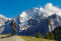 Elderly coule walking near Murren, Swiss Alps, Switzerland