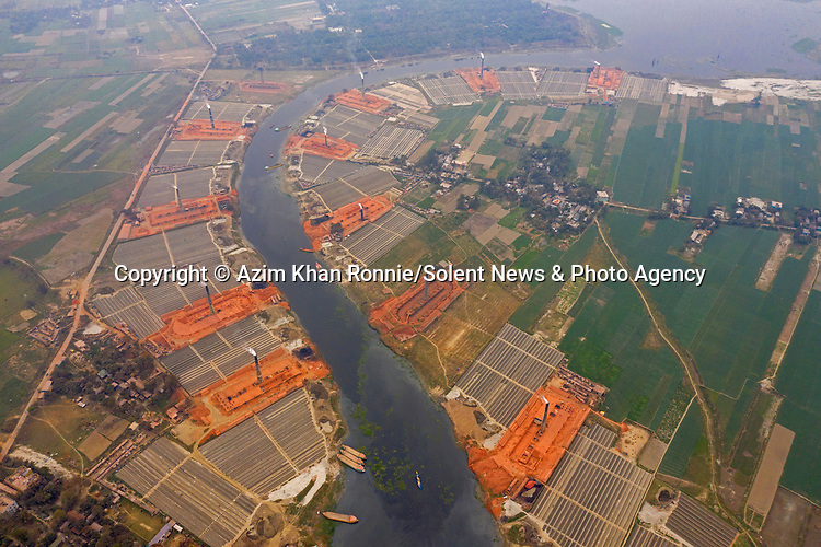 Pictured: The same brick factories pre-flooding.<br /> <br /> Hundreds of brick factories appear to have nearly disappeared under water following severe flooding.  The buildings were covered with water within three days of heavy rainfall after a nearby river breached its banks.<br /> <br /> Workers were able to save thousands of bricks - but many were lost to the 20 ft deep floodwater.  Photographer Azim Khan Ronnie pictured the flooded brick factories in Zazira near his home in Dhaka, Bangladesh.<br /> <br /> Please byline: Azim Khan Ronnie/Solent News<br /> <br /> © Azim Khan Ronnie/Solent News & Photo Agency<br /> UK +44 (0) 2380 458800
