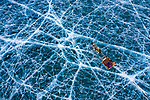 ONLINE ARE RESTRICTED TO A MAXIMUM OF 10 IMAGES  FROM THIS SET TO RUN ALONGSIDE THE STORY<br /> <br /> Pictured: Taken from by Drone:  Frozen lake in Khuvsgul, Mongolia.<br /> <br /> Amazing drone shots show a Mongolian tribesman sledding across a frozen lake, the skyscrapers of Dubai shrouded in mist and a fluorescent blue stream winding its way through the ice of Greenland.  Other images show fields of flowers in Italy and a herd of livestock being guided through the desert.<br /> <br /> The patterned pictures - which resemble modern art - were captured by photographer Alessandra Meniconzi from Lugano, Switzerland.  SEE OUR COPY FOR DETAILS.<br /> <br /> Please byline: Alessandra Meniconzi/Solent News<br /> <br /> © Alessandra Meniconzi/Solent News & Photo Agency<br /> UK +44 (0) 2380 458800