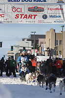 Seth Barnes and team leave the ceremonial start line with an Iditarider at 4th Avenue and D street in downtown Anchorage, Alaska on Saturday March 2nd during the 2019 Iditarod race. Photo by Brendan Smith/SchultzPhoto.com