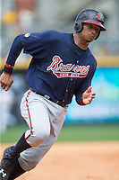 Christian Bethancourt (38) of the Gwinnett Braves hustles towards third base against the Charlotte Knights at BB&T BallPark on July 3, 2015 in Charlotte, North Carolina.  The Braves defeated the Knights 11-4 in game one of a day-night double header.  (Brian Westerholt/Four Seam Images)