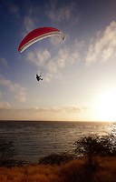 Paraglider enjoying a sunset flight off the slopes of Diamond Head.