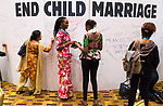 26 June, 2018, Kuala Lumpur, Malaysia :Nene Goita of Mali (Red dress) writing on the board in the Village during the second day at the Girls Not Brides Global Meeting 2018 at the Kuala Lumpur Convention Centre. Picture by Graham Crouch/Girls Not Brides