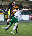 Alloa's Ben Gordon is booked for dragging back Hib's Martin Boyle.
