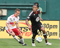 Jordan Graye #16 of D.C. United moves the ball away from Seth Stammler #6 of the New York Red Bulls during an MLS match on May 1 2010, at RFK Stadium in Washington D.C.