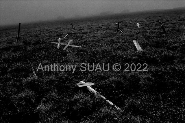 Yakutia.Siberia, Russia.1995.Above the artic circle lays one of the most horrible Gulags known in the former Soviet ties. These crosses are a memorial to the thousands who died in Ambarhick and are buried below. the ruins are the entance to the camp.
