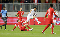 TORONTO, ON - OCTOBER 15: Cristian Roldan #15 of the United States moves past Scott Arfield #8 of Canada during a game between Canada and USMNT at BMO Field on October 15, 2019 in Toronto, Canada.