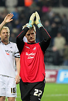 Pictured: Alan Tate of Swansea who substituted injured goalkeeper Dorus de Vries thanks his team's supporters after the final whistle. <br /> Re: Coca Cola Championship, Swansea City Football Club v Queens Park Rangers at the Liberty Stadium, Swansea, south Wales 21st October 2008.