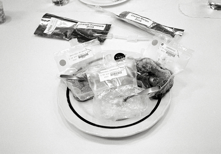 Image copyright John Angerson. <br /> STS-72 mission training.<br /> Space Food testing department. Food consumed during space missions was designed to be nutritious, easily digestible, palatable, and easy to use while in a <br /> zero gravity environment. NASA used retort pouches or the freeze-drying process. <br /> Johnson Space Center Houston, Texas, USA.