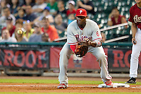 Philadelphia Phillies first baseman Ryan Howard #6 receives a throw at first during the Major League baseball game against the Houston Astros on September 16th, 2012 at Minute Maid Park in Houston, Texas. The Astros defeated the Phillies 7-6. (Andrew Woolley/Four Seam Images).