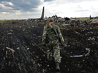 Pro-Russian militia secure the impact area of downed Ukrainian military transport plane (IL-76). Novogannivka, ( Lugansk ), Ukraine.<br />