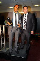 Pictured L-R: Ashley Williams receiving the Club Ambassador of the Year award by Ammcom manager. Thursday 10 May 2012<br />