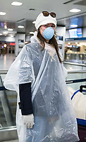 """New York, New York City. New Yorkers are told to stay home during the corona virus, (COVID-19) so New York has become eerily empty. Penn Station. """"My Mom made me dress like this,""""says a passenger about to embark the Amtrak train back hme to Virgina at a nearly empty Penn Station."""