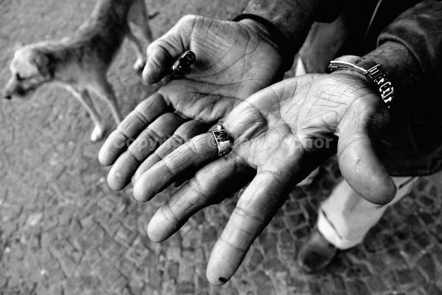 A Brazilian man, living on the street, shows his empty hands, Sao Paulo, Brazil, 20 February 2004.