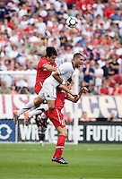 Clint Dempsey (8) of the USMNT goes up for a header against Gokhan Zan (4) and Mehmet Topal (15) of Turkey at Lincoln Financial Field in Philadelphia, PA.  The USMNT defeated Turkey, 2-1.