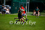 Churchill's Gary Rolls and Paul McMahon of St Pats Blennerville collide during their encounter in the County Senior football league on Sunday.