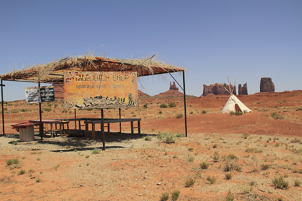 Tee-pee tent and indian jewelry stand in Monument Valley, Arizona, USA. . John offers private photo tours in Monument Valley and throughout Arizona, Utah and Colorado. Year-round.