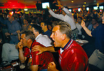 British football fans World Cup 1998. Supporters watching a penalty shoot out between England and Argentina that decided the game, Argentina won 4–3 after two English kicks were saved. England was  knocked out of the World Cup. Sports Bar, London 1990s UK