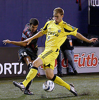 The MetroStars' Kenny Arena attempts to cross the ball past the Crew's Michael Ritch. The Columbus Crew and the MetroStars played to a 1-1 tie in regular season MLS action on Saturday October 9, 2004 at Giant's Stadium, East Rutherford, NJ..