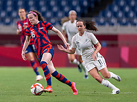 SAITAMA, JAPAN - JULY 24: Rose Lavelle #16 of the USWNT dribbles during a game between New Zealand and USWNT at Saitama Stadium on July 24, 2021 in Saitama, Japan.