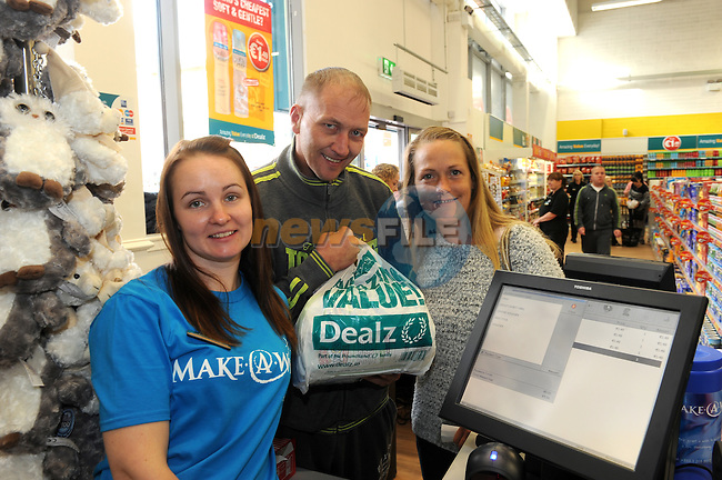 FREE PIC - NO REPRO FEE<br /> 24/09/2015 - Blackpool, Cork<br /> Christina and Martin Yelverton with store assistant Sarah McCarthy at the official opening of the new Dealz store at Blackpool Retail Park, Cork.<br /> Pic: Brian Lougheed