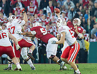 PASADENA, CA - January 1, 2013: Stanford quarterback Kevin Hogan (8) passes the ball during the Stanford Cardinal vs the Wisconsin Badgers in the 2013 Rose Bowl Game in Pasadena, California. Final score Stanford 20, Wisconsin 14.