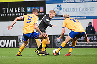 Lincoln City's Anthony Scully battles with Mansfield Town's Ryan Sweeney, left, and Aaron O'Driscoll<br /> <br /> Photographer Andrew Vaughan/CameraSport<br /> <br /> EFL Trophy Northern Section Group E - Mansfield Town v Lincoln City - Tuesday 6th October 2020 - Field Mill - Mansfield  <br />  <br /> World Copyright © 2020 CameraSport. All rights reserved. 43 Linden Ave. Countesthorpe. Leicester. England. LE8 5PG - Tel: +44 (0) 116 277 4147 - admin@camerasport.com - www.camerasport.com