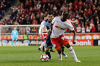 Harrison, NJ - Wednesday Feb. 22, 2017: Russell Teibert, Bradley Wright-Phillips during a Scotiabank CONCACAF Champions League quarterfinal match between the New York Red Bulls and the Vancouver Whitecaps FC at Red Bull Arena.