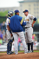 Burlington Bees pitching coach Jairo Cuevas (50) talks with starting pitcher Ronnie Glenn (25) and catcher Angel Genao during a game against the Quad Cities River Bandits on May 9, 2016 at Modern Woodmen Park in Davenport, Iowa.  Quad Cities defeated Burlington 12-4.  (Mike Janes/Four Seam Images)