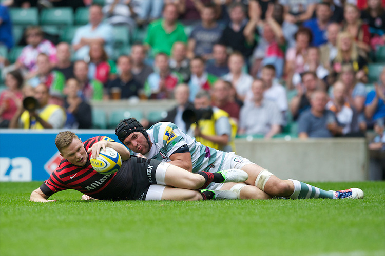 Chris Ashton of Saracens ignores the attentions of Bryn Evans of London Irish to score a try during the Aviva Premiership match between Saracens and London Irish at Twickenham on Saturday 1st September 2012 (Photo by Rob Munro)