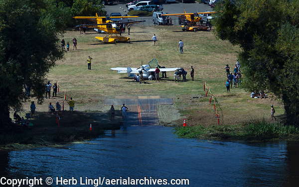 Aerial photograph of the seaplane ramp at the Clear Lake Seaplane Splash-In, Lakeport, Lake County, California is temporarily closed as pilots and mechanics assist Kent Carlomagno with a gear issue with his Seamax M-22, N153KC.