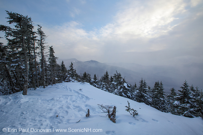 February 2015 - View of snow blowing across the mountains from the summit of Mount Tecumseh in Waterville Valley, New Hampshire during the winter months. Illegal tree cutting has improved the view from the summit. Forest Service verified the tree cutting on the summit is illegal.