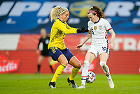 SOLNA, SWEDEN - APRIL 10: Rose Lavelle #16 of the United States moves with the ball during a game between Sweden and USWNT at Friends Arena on April 10, 2021 in Solna, Sweden.