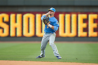 Myrtle Beach Pelicans second baseman Daniel Lockhart (7) makes a throw to first base against the Winston-Salem Dash at BB&T Ballpark on May 10, 2015 in Winston-Salem, North Carolina.  The Pelicans defeated the Dash 4-3.  (Brian Westerholt/Four Seam Images)
