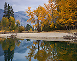 Yosemite National Park, CA: Calm reflections along the Merced River with Sentinel Dome in the distance in fall.