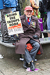 © Joel Goodman - 07973 332324 - all rights reserved . 20/03/2010 . Bolton , UK . World War Two veteran Bertie Lois , protesting with UAF . The English Defence League ( EDL ) hold a demonstration in Bolton , opposed by Unite Against Fascism ( UAF ) . Photo credit : Joel Goodman