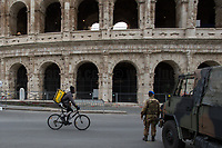 """Food Runners and Delivery: allowed.<br /> <br /> Colosseum: Closed.<br /> <br /> Rome, 12/03/2020. Documenting Rome under the Italian Government lockdown for the Outbreak of the Coronavirus (SARS-CoV-2 - COVID-19) in Italy. On the evening of the 11 March 2020, the Italian Prime Minister, Giuseppe Conte, signed the March 11th Decree Law """"Step 4 Consolidation of 1 single Protection Zone for the entire national territory"""" (1.). The further urgent measures were taken """"in order to counter and contain the spread of the COVID-19 virus"""" on the same day when the WHO (World Health Organization, OMS in Italian) declared the coronavirus COVID-19 as a pandemic (2.).<br /> ISTAT (Italian Institute of Statistics) estimates that in Italy there are 50,724 homeless people. In Rome, around 20,000 people in fragile condition have asked for support. Moreover, there are 40,000 people who live in a state of housing emergency in Rome's municipality.<br /> March 11th Decree Law (1.): «[…] Retail commercial activities are suspended, with the exception of the food and basic necessities activities […] Newsagents, tobacconists, pharmacies and parapharmacies remain open. In any case, the interpersonal safety distance of one meter must be guaranteed. The activities of catering services (including bars, pubs, restaurants, ice cream shops, patisseries) are suspended […] Banking, financial and insurance services as well as the agricultural, livestock and agri-food processing sector, including the supply chains that supply goods and services, are guaranteed, […] The President of the Region can arrange the programming of the service provided by local public transport companies […]».<br /> Updates: on the 12.03.20 (6:00PM) in Italy there 14.955 positive cases; 1,439 patients have recovered; 1,266 died.<br /> <br /> Footnotes & Links:<br /> Info about COVID-19 in Italy: http://bit.do/fzRVu (ITA) - http://bit.do/fzRV5 (ENG)<br /> 1. March 11th Decree Law http://bit.do/fzREX (ITA) - http://bit.do/fzRFz (E"""