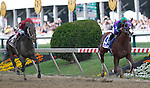 May 17, 2014. California Chrome, Victor Espinoza up, beats Ride On Curlin (left) by three and a half lengths to win the 139th Preakness Stakes, at Pimlico Race Course in Baltimore, MD. ©Joan Fairman Kanes/ESW/CSM