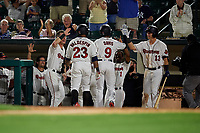 Rochester Red Wings Jaylin Davis (9) high fives Brian Schales (13), Nick Gordon (1), and Brent Rooker (left) after hitting a home run during an International League game against the Scranton/Wilkes-Barre RailRiders on June 24, 2019 at Frontier Field in Rochester, New York.  Jordany Valdespin (23) scored on the home run.  Rochester defeated Scranton 8-6.  (Mike Janes/Four Seam Images)