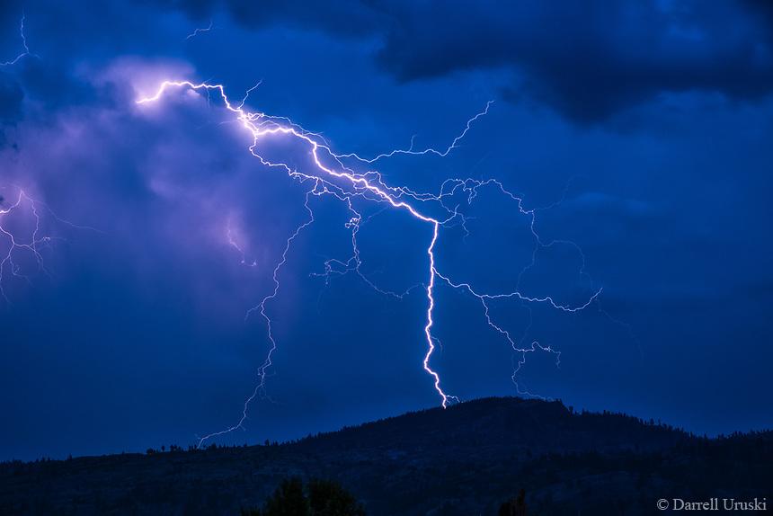 Lightning strike in the Okanagan Valley between the Columbia and Cascade mountain range of British Columbia.