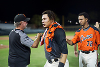 AZL Giants designated hitter Diego Rincones (35) is congratulated by coaches and teammates after a walk-off single against the AZL Rangers on September 4, 2017 at Scottsdale Stadium in Scottsdale, Arizona. AZL Giants defeated the AZL Rangers 6-5 to advance to the Arizona League Championship Series. (Zachary Lucy/Four Seam Images)