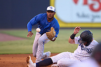 Dunedin Blue Jays third baseman Harrison Ray (2) attempts to catch a throw as Andres Chaparro (24) slides in during a game against the Tampa Tarpons on May 7, 2021 at George M. Steinbrenner Field in Tampa, Florida.  (Mike Janes/Four Seam Images)