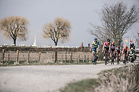 Early break away group over the 'plugstreet Christmas Truce' gravel section with WWI cemetry in the background.<br /> <br /> 81st Gent-Wevelgem in Flanders Fields (1.UWT)<br /> Deinze > Wevelgem (251km)