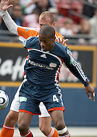 New England Revolution defender Chris Aloisi (4) shields the ball from Houston Dynamo defender Paul Dalglish (8).  The Houston Dynamo win MLS Cup 2006 over the New England Revolution after playing to a 1-1 tie during regulation and extra time at Pizza Hut Park in Frisco, TX on November 12, 2006.