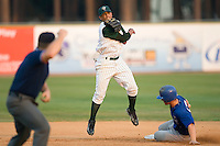 Shortstop Juan Lagares (4) of the Savannah Sand Gnats turns a double play at Grayson Stadium in Savannah, GA, Wednesday August 6, 2008  (Photo by Brian Westerholt / Four Seam Images)