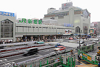 South Exit of Shinjuku Station, Tokyo, Japan. With up to 4 million passengers passing through it every day, Shinjuku station, Tokyo, Japan, is the busiest train station in the world. The station was used by an average of 3.64 million people per day.  That's 1.3 billion a year.  Or a fifth of humanity. Shinjuku has 36 platforms, and connects 12 different subway and railway lines.  Morning rush hour is pandemonium with all trains 200% full. <br /> <br /> Photo by Richard jones / sinopix