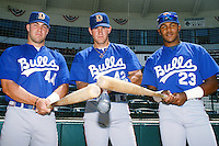 Ron Wright (44), Wes Helms (42), and Andruw Jones (23) of the Durham Bulls pose for a photo before the Carolina League versus California League All Star Game during the 1996 season at The Epicenter in Rancho Cucamonga, California. (Larry Goren/Four Seam Images)