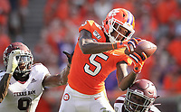 Clemson Tigers wide receiver Tee Higgins catches a Trevor Lawrence pass in front of Texas A&M defensive back Leon O'Neal Jr. and defensive back Roney Elam during an ACC college football game in Clemson.(Travis Bell/SIDELINE CAROLINA)
